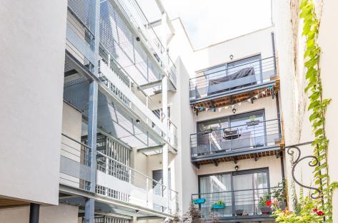 logement bruxelles Flandre eon architecture urbanisme passerelle acier galvanise